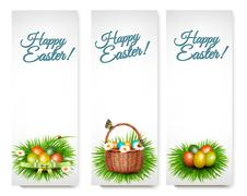 Three Happy Easter banners with easter eggs in a basket and grren grass. Vect Stock Illustration
