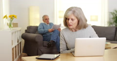 Seniors with electronic gadgets Stock Footage