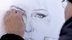 Artist making a draw of a young woman Stock Footage