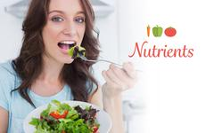 Nutrients against brunette eating healthy salad Stock Photos