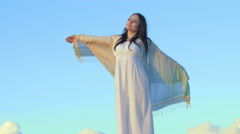 Daydreaming woman like an angel with a beautiful blue sky in background Stock Footage