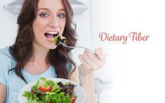 Dietary fiber against brunette eating healthy salad - stock photo