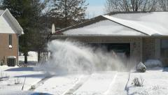 4K shot of man removing snow with snow blower Stock Footage