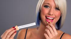 Pretty Blonde Woman Eats Fortune Cookie Showing Message Stock Photos