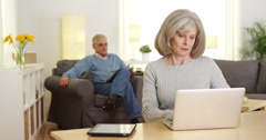 Mature adults using laptop computer Stock Footage