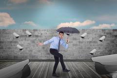 Composite image of anxious businessman under umbrella balancing - stock illustration