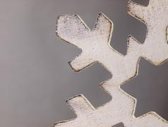 Wooden Christmas ornament in the shape of a snowflake. Stock Photos