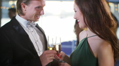 4K Attractive couple walk out onto deck, at elegant party on board river boat Stock Footage
