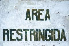 old sign with the Spanish statement  - stock photo