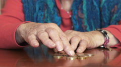 Old woman is counting for her little money left Stock Footage