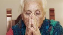 Catholic old woman in prayer: God, seeking, faith, religious Stock Footage