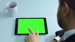 businessman working on tablet computer with green screen (alpha channel) - stock footage