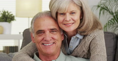 Senior couple smiling looking at camera Stock Footage