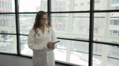 A Caucasian Female Medical Professional Walks Up to the Camera (9 of 9) - stock footage