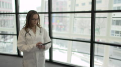 A Caucasian Female Medical Professional Walks Up to the Camera (8 of 9) - stock footage
