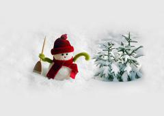 Snowman in snow - stock photo