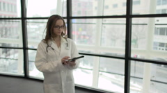A Caucasian Female Medical Professional Walks Up to the Camera (2 of 9) - stock footage