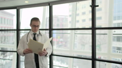 A Caucasian Male Medical Professional Walks Up to the Camera (10 of 10) - stock footage
