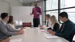 A Professional Black Man Leading a Meeting (1 of 3) - stock footage