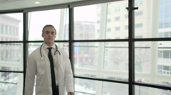 A Caucasian Male Medical Professional Walks Up to the Camera (3 of 10) - stock footage
