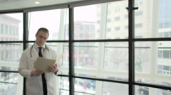 A Caucasian Male Medical Professional Walks Up to the Camera (6 of 10) - stock footage