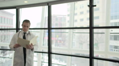 A Caucasian Male Medical Professional Walks Up to the Camera (7 of 10) Stock Footage