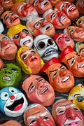 Traditional paper masks for New Year celebration in Ecuador - stock photo