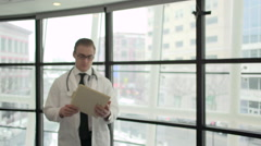 A Caucasian Male Medical Professional Walks Up to the Camera (1 of 10) - stock footage