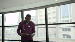 A Black Male Medical Professional Walks Up to the Camera (1 of 5) - stock footage