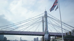4K The Albert Bridge at Chelsea Harbour, viewed from a boat on the River Thames Stock Footage