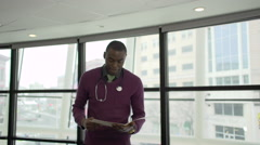 A Black Male Medical Professional Walks Up to the Camera (4 of 5) - stock footage