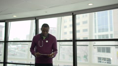 A Black Male Medical Professional Walks Up to the Camera (2 of 5) - stock footage