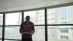 A Black Male Medical Professional Walks Up to the Camera (3 of 5) - stock footage