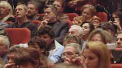 People attending lecture seated listening Stock Footage