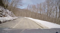 Winding curvy mountain road snow winter Stock Footage