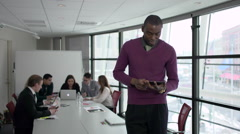 A Black Man Stands Infront of Professionals in a Meeting (4 of 4) - stock footage