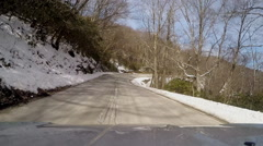 Winding curves mountain roadway snowy Stock Footage