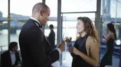 4K Attractive couple walk out onto deck, at elegant party on board river boat - stock footage