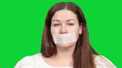 Sad Caucasian woman pointing at tape on the mouth, speechless man Stock Footage