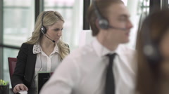 Blonde Caucasian Woman Works in a Attractive Modern Call Center (3 of 3) - stock footage