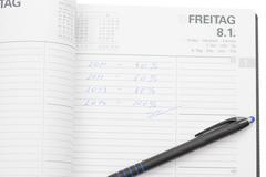 Pocket Planner and Pencil Isolated - stock photo