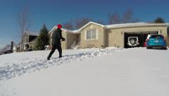 Clearing snow from driveway time lapse Stock Footage