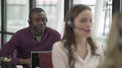 A Black Man Works in a Attractive Modern Call Center (1 of 4) - stock footage