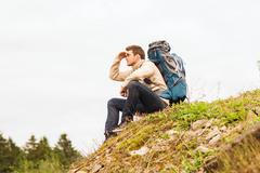 man with backpack hiking - stock photo