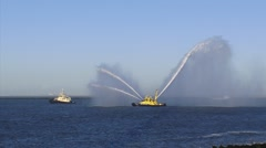 Fireboat RPA 12 performs a water salute, moving shadow cast by a wind turbine. Stock Footage