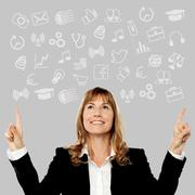 Stock Photo of Middle aged woman pointing media icons