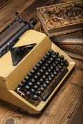 Stock Photo of old typewriter, a pile of books and a lot of creativity