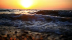 Bright sunset under the sea with waves splashes, fly spray and beautifully Stock Footage