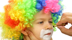 Make-up boy in clown wig Stock Footage