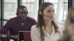 A Black Man Works in a Attractive Modern Call Center (4 of 4) - stock footage